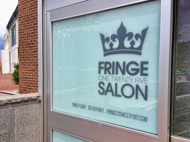Custom oversized vinyl window decal for the front window adjacent to the salons elevator entrance since the business was located on the 3rd floor